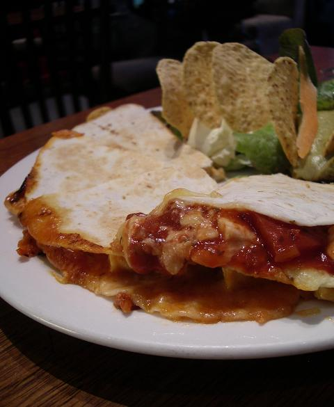 Quesadilla - Two tortillas grilled together with chicken, shallots, salsa & cheese. Served with guacamole, sour cream & corn chips. Just what the doctor ordered.