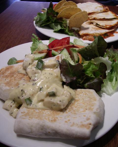 Enchilladas - Creamy cheese sauce consisting of cheese, sour cream, shallots, mushrooms & Italian seasoning along with tender chunks of chicken breast grilled in two tortillas.